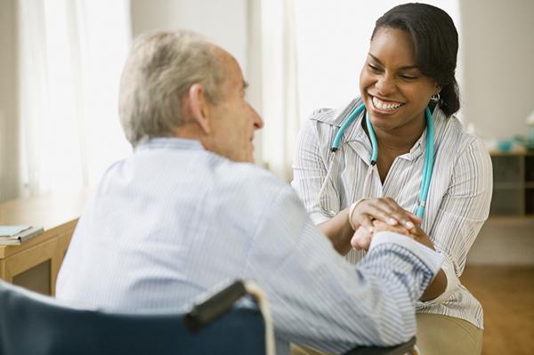 docotr talking with elderly patient